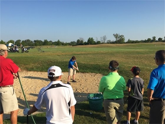 Junior Golf Academy learning to hit out of a sandtrap